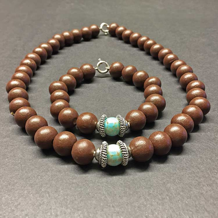 set van armband en collier met turkoois en zilveren ornament