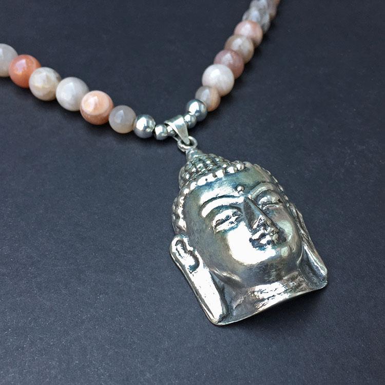 collier sunstone van heaven eleven met zilveren buddha